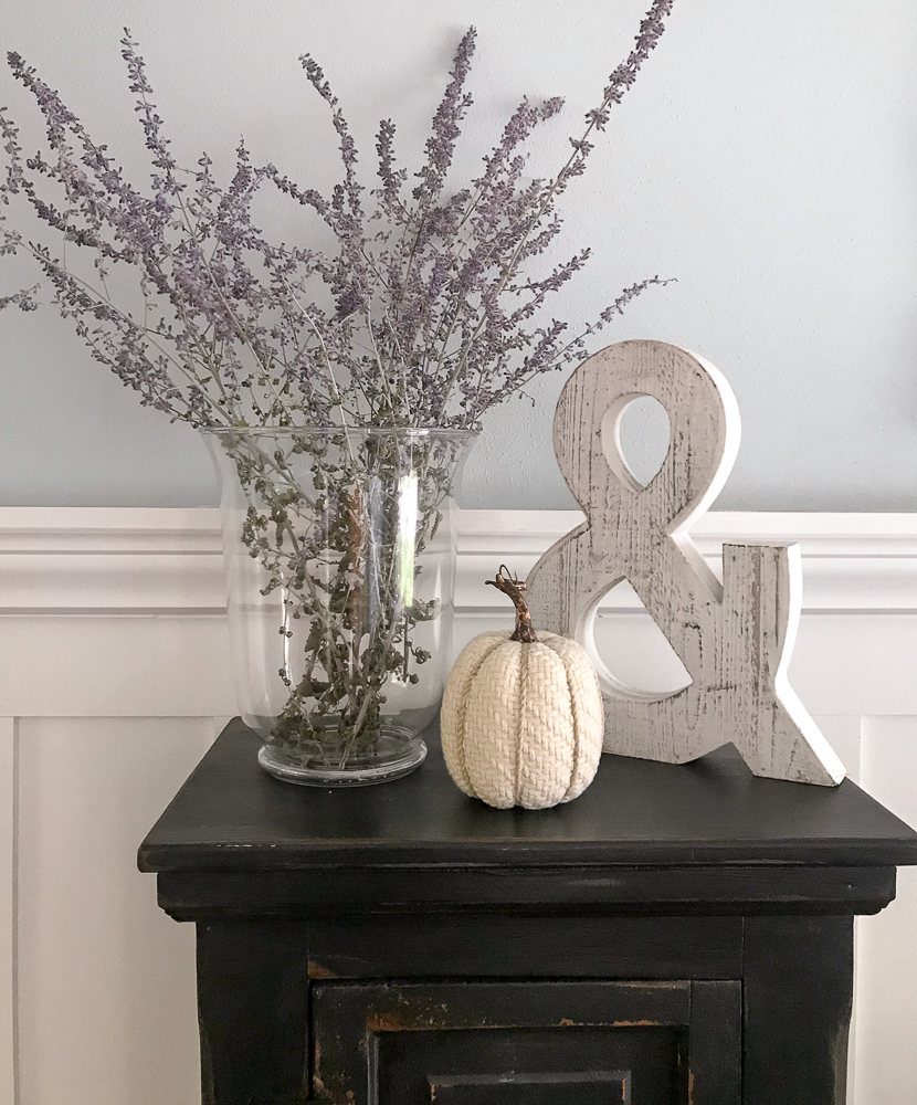 russian sage and fall decor on black stand