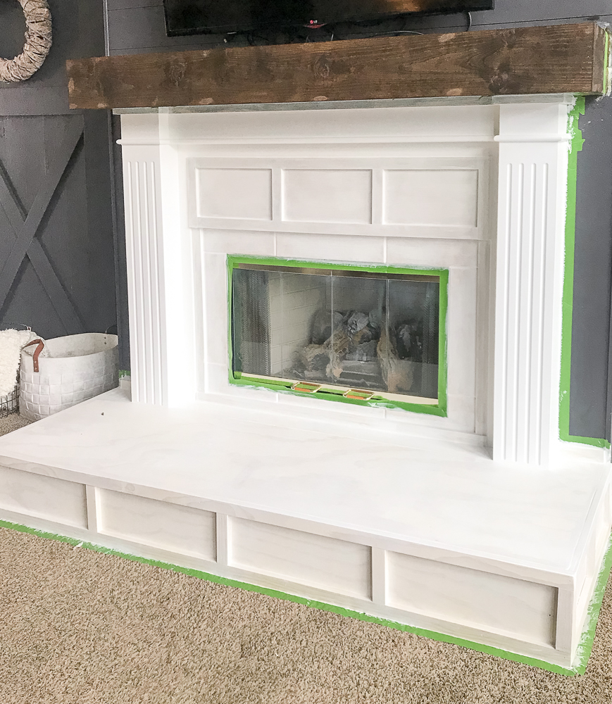 fireplace painted white with primer