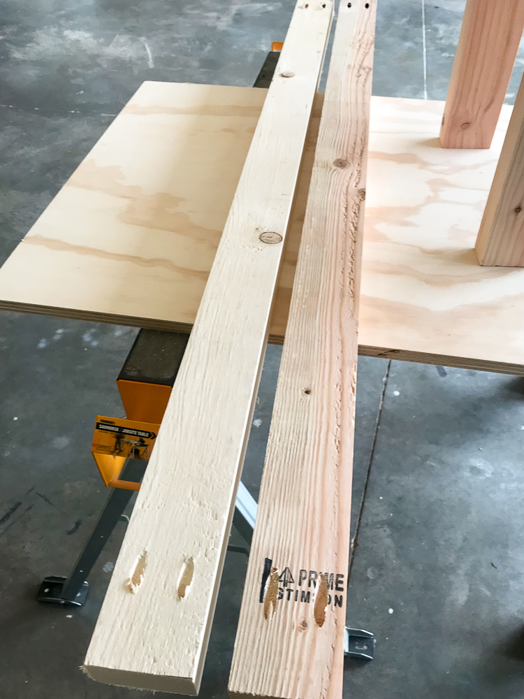 two 2x4's on a sheet of plywood