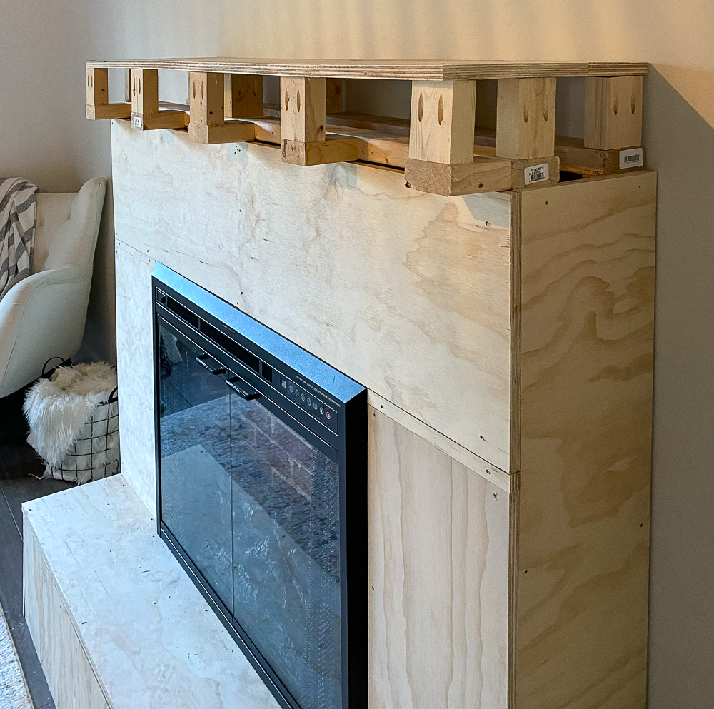 """Hearth and mantel of fireplace added onto 2x4's using 3/4"""" plywood"""