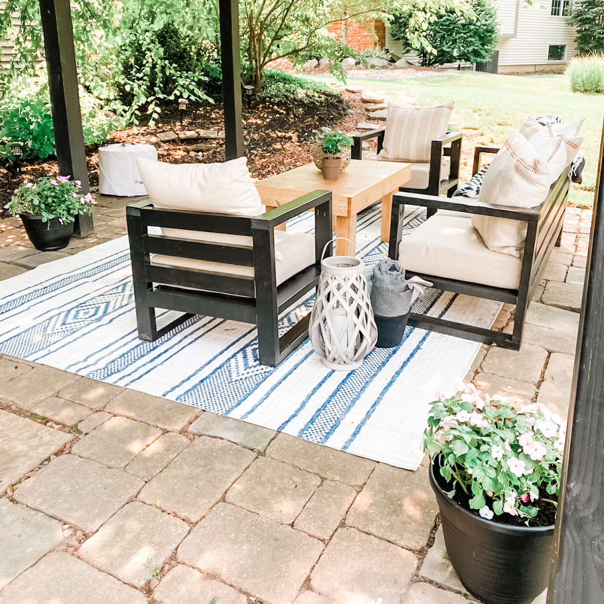 Pergola space with outdoor furniture and new planters