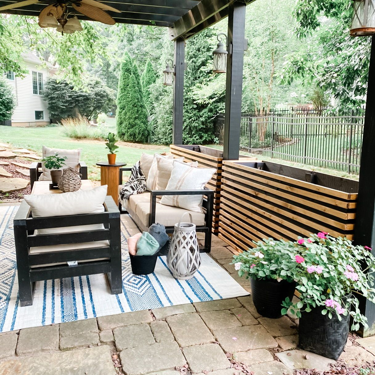 Pergola space with outdoor furniture and planters