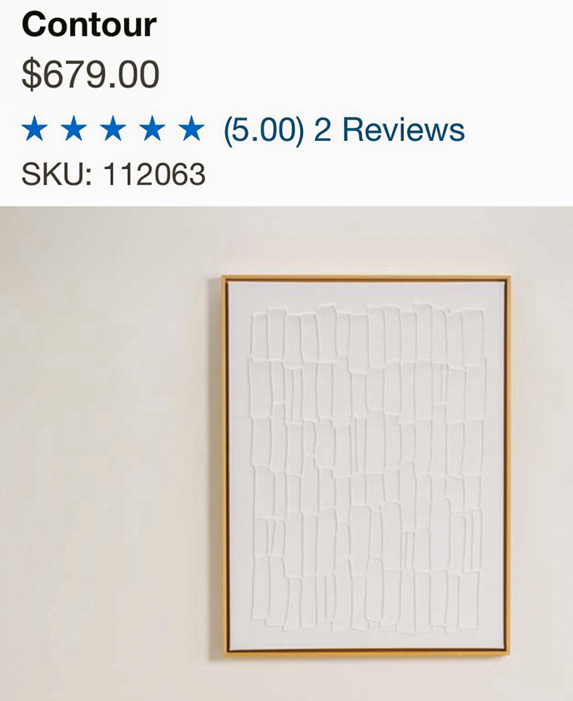 Canvas wall art on a wall with the price from Crate and Barrel. Priced at $679