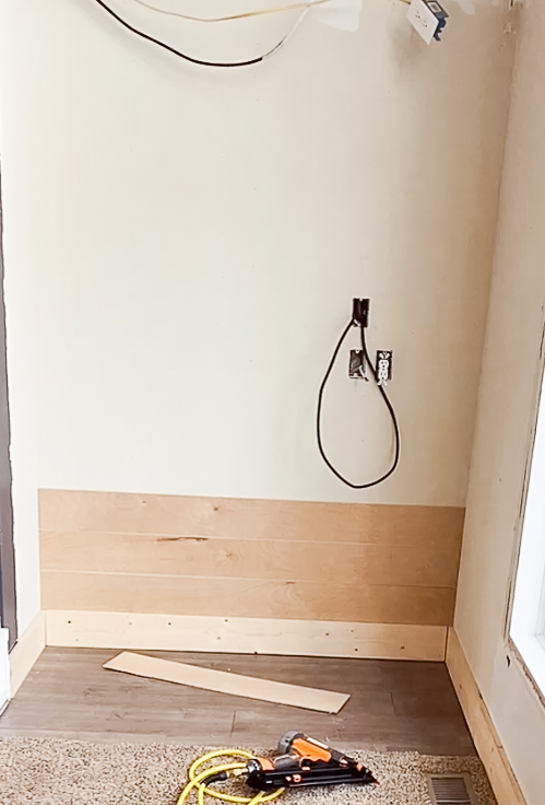 Shiplap on a wall where a corner cabinet used to sit