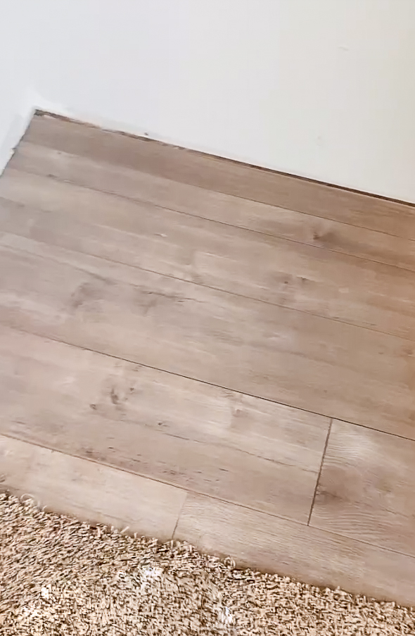 Laminate flooring where a corner cabinet used to sit