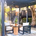 Solostove firepit on an outdoor patio with furniture and lots of trees