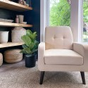 Cream color chair with a fiddle leaf fig behind it, large windows and diy floating shelves