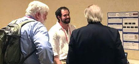 Matt Higger discusses Shuffle Speller with Gregg Vanderheiden and Denis Anson at the RESNA 2017 Conference.