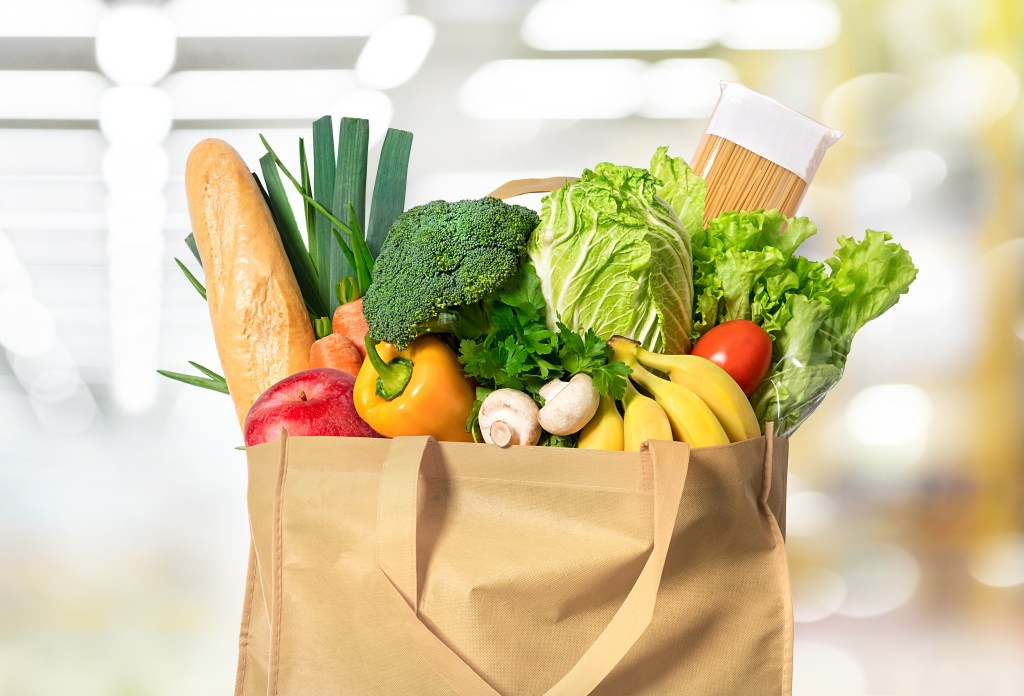 Eco friendly reusable shopping bag filled with vegetables shopping organic on budget
