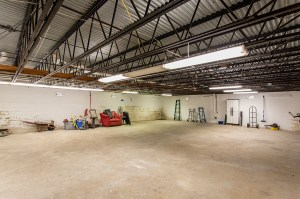 Cavernous Drive-Under Garage / Basement with Room for Multiple Vehicles