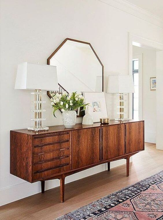 sleek entryway table/console with geometric mirror