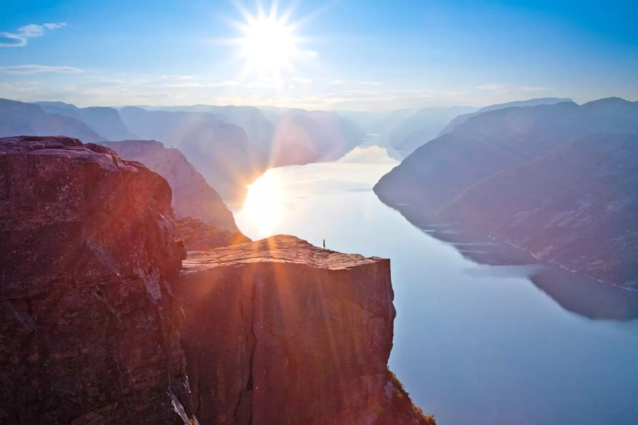 View from Preikestolen in Norway - A huge mountain overlooking the river