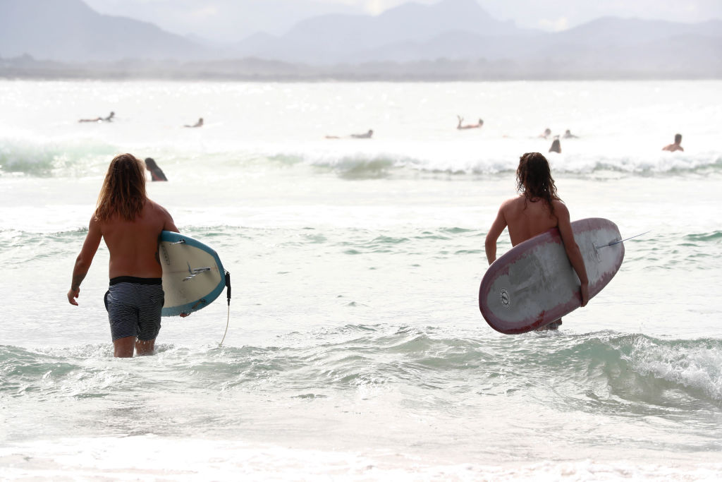 Surfers at The Pass, Byron Bay.