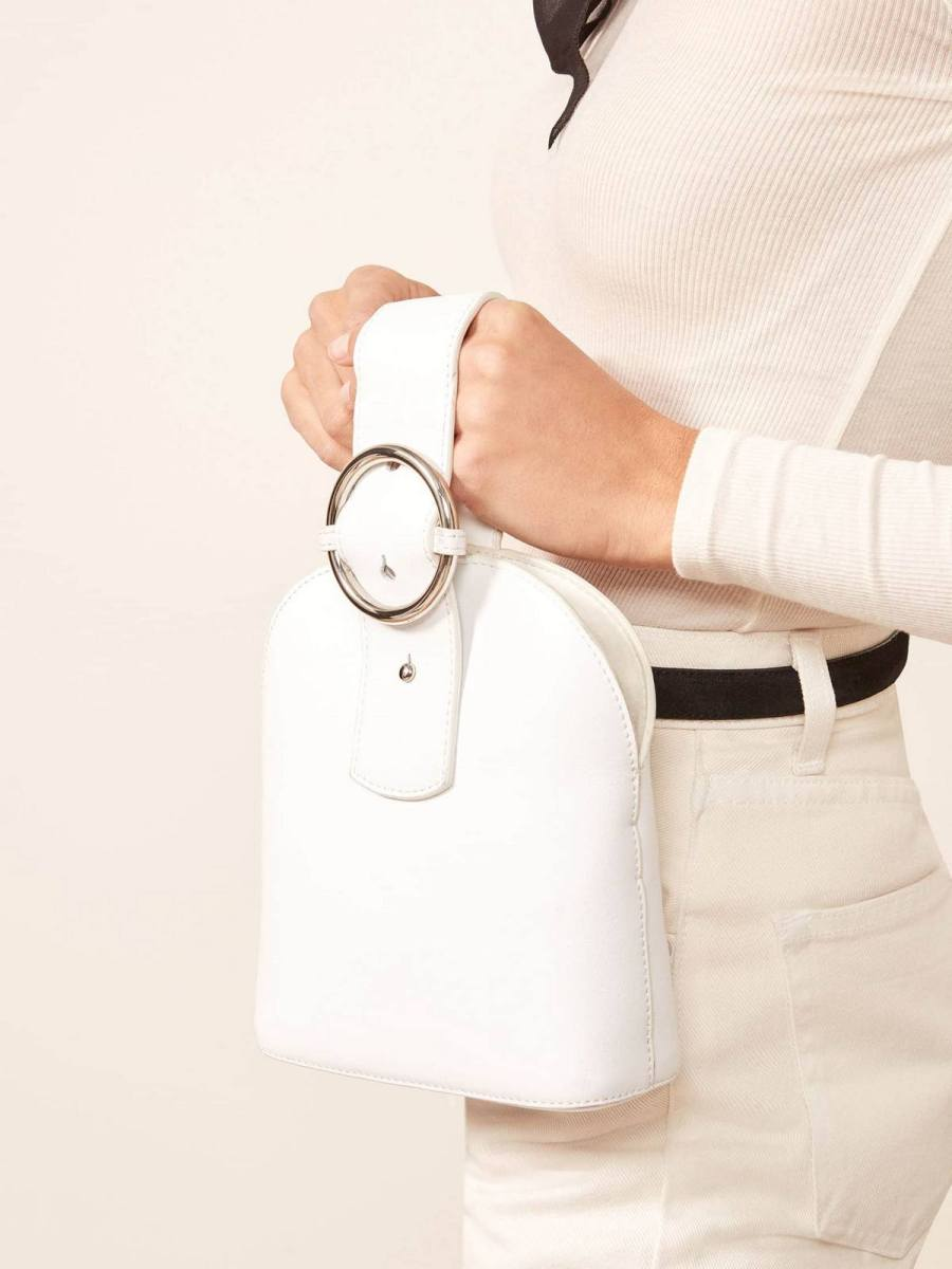 We'll always love (and need) our trusty tote bag, but if you're looking to lighten the load in 2020 there is a new handbag trend that can handle just the essentials in style — the bracelet bag.