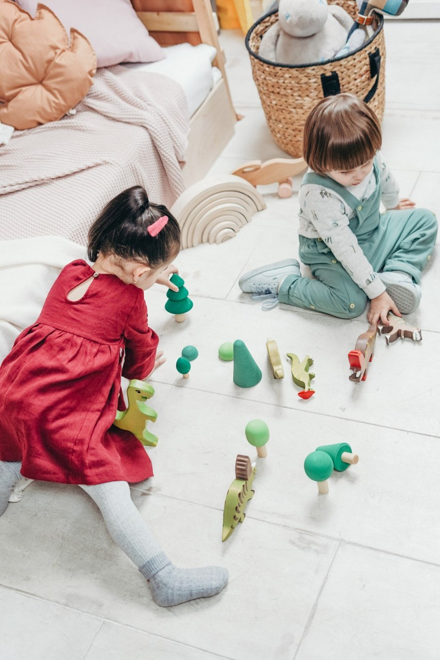 Play enables children to practice the language skills they have learned and build on their expanding vocabulary. Interacting with adults and peers also enables children to refine their speech sounds through listening to others.