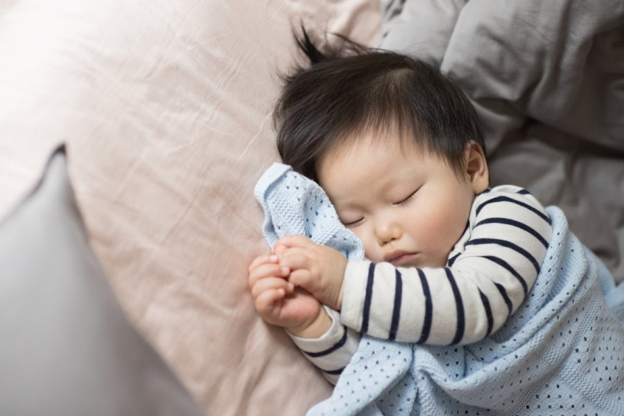 Having baby sleep close by is a source of comfort for both of you, but at some point you'll need to transition him out of your room and into his own.
