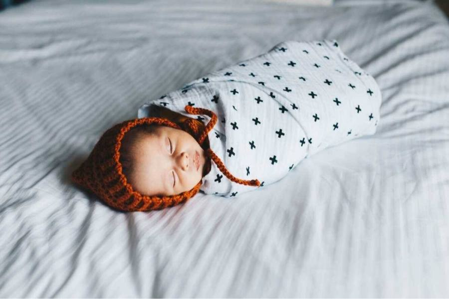 Are you confused about when to stop swaddling your baby? For centuries, moms and dads have swaddled babies. Why? Because it is so effective for calming infants and helping them sleep better.