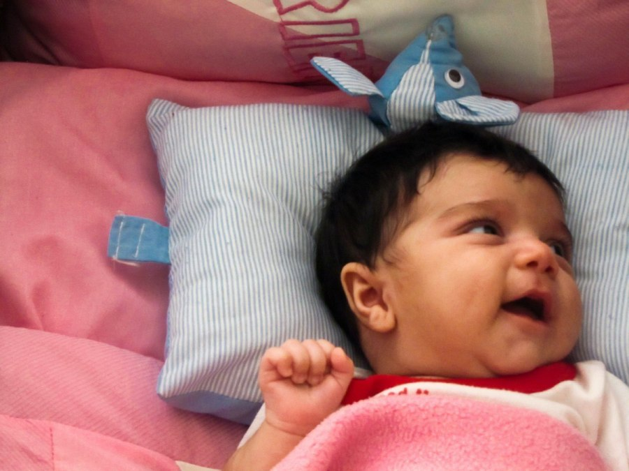 Your baby can't sleep with a pillow until she's a toddler. Babies should sleep on a firm, flat surface free of pillows, blankets, and other soft bedding until at least age 1 and preferably age 18 months or later, according to the American Academy of Pediatrics' safe sleep guidelines.