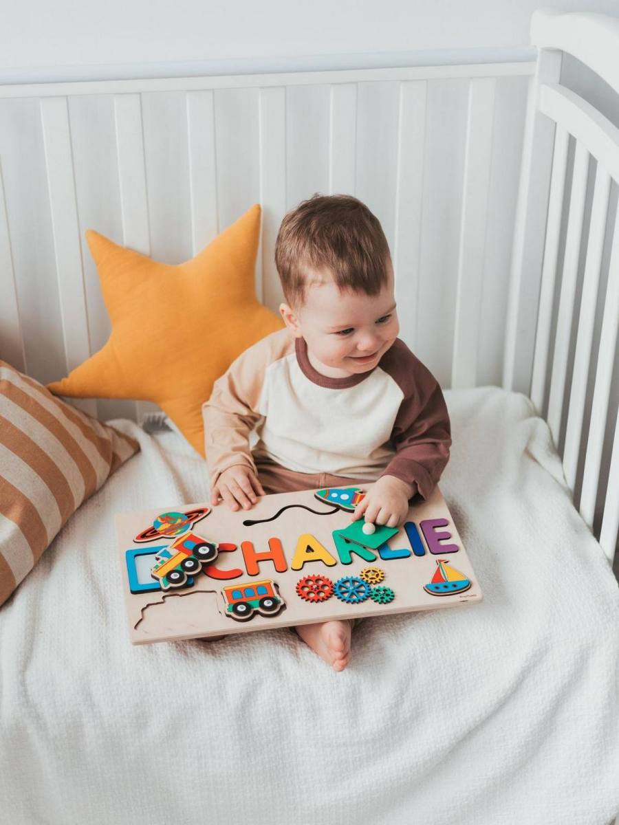 """Busy boards, also known as activity boards, are a sensory, safe board filled with everyday items. This provides babies and toddlers with a safe space to play with normally """"forbidden"""" items."""