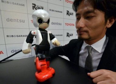 Tomotaka Takahashi demonstrates robot Kirobo in Tokyo.