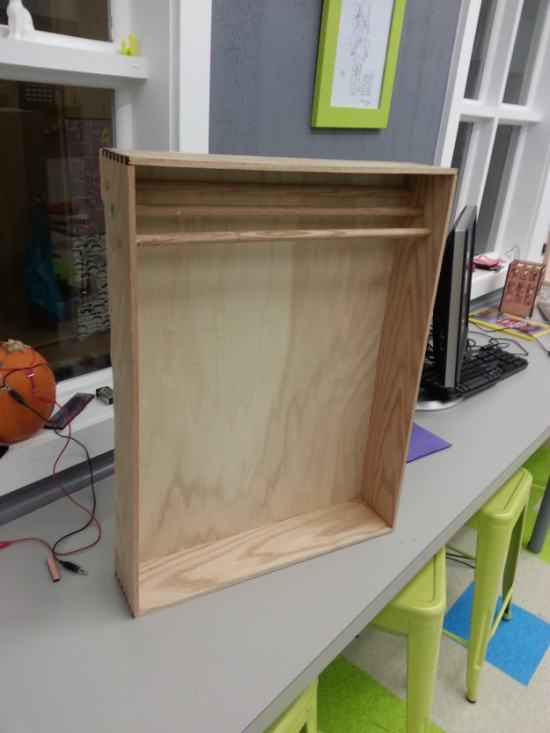 Red oak medal rack with laser cut dove tail joinery.