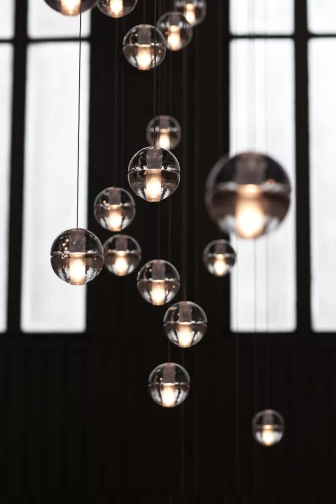 14 Is An Articulated Cast Glass Sphere With A Frosted Cylindrical Void That Houses Either Low Voltage Xenon Or Led Lamp Individual Pendants Are Visually