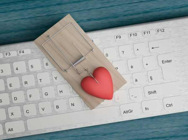 A love heart in a mousetrap sitting on a computer keyboard