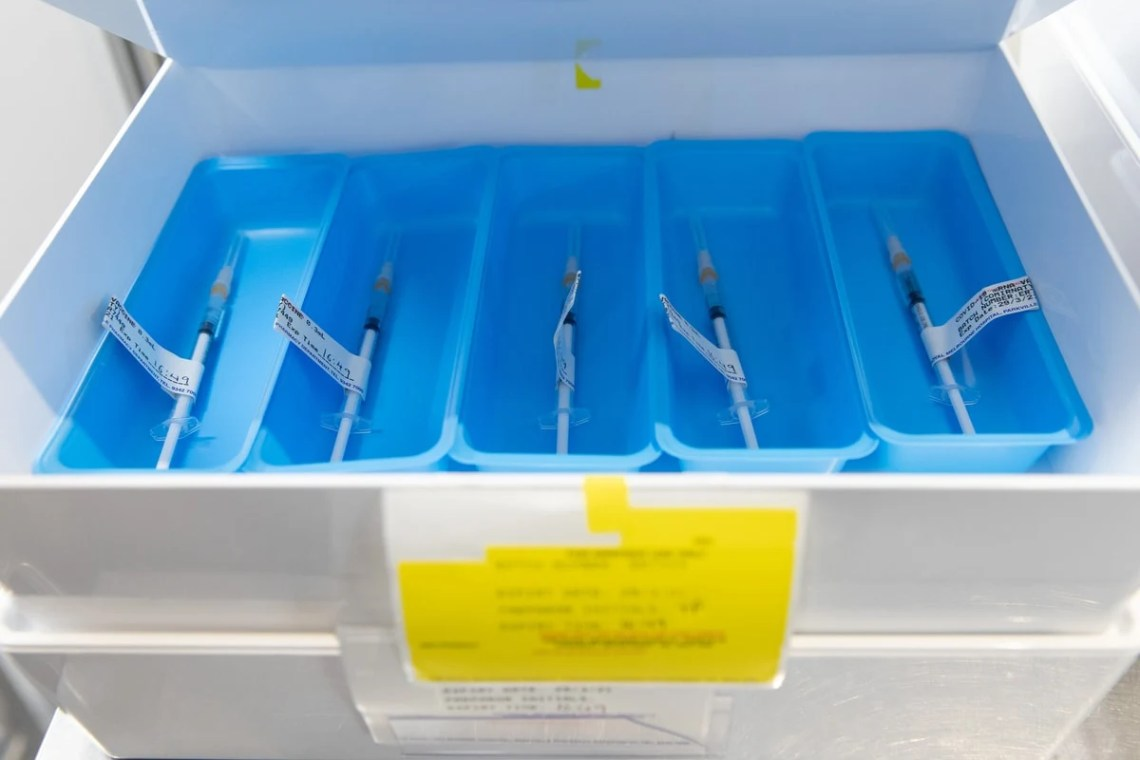 Trays of individual COVID vaccination syringes