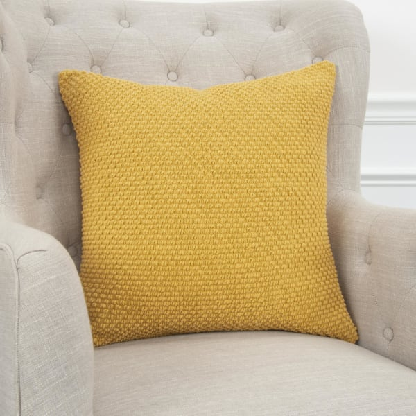 textured solid yellow throw pillow