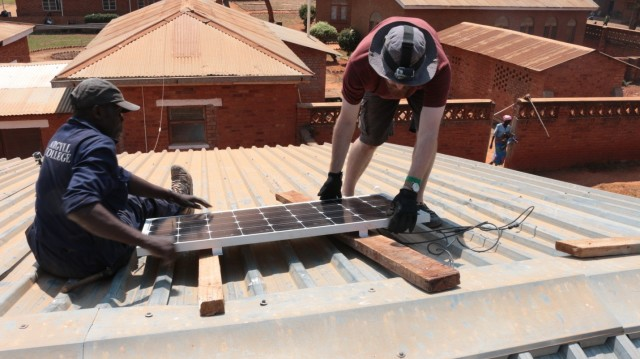 Installation of the S4 Solar Panel at Embangweni Hospital. (Image courtesy of Grand Valley State University.)