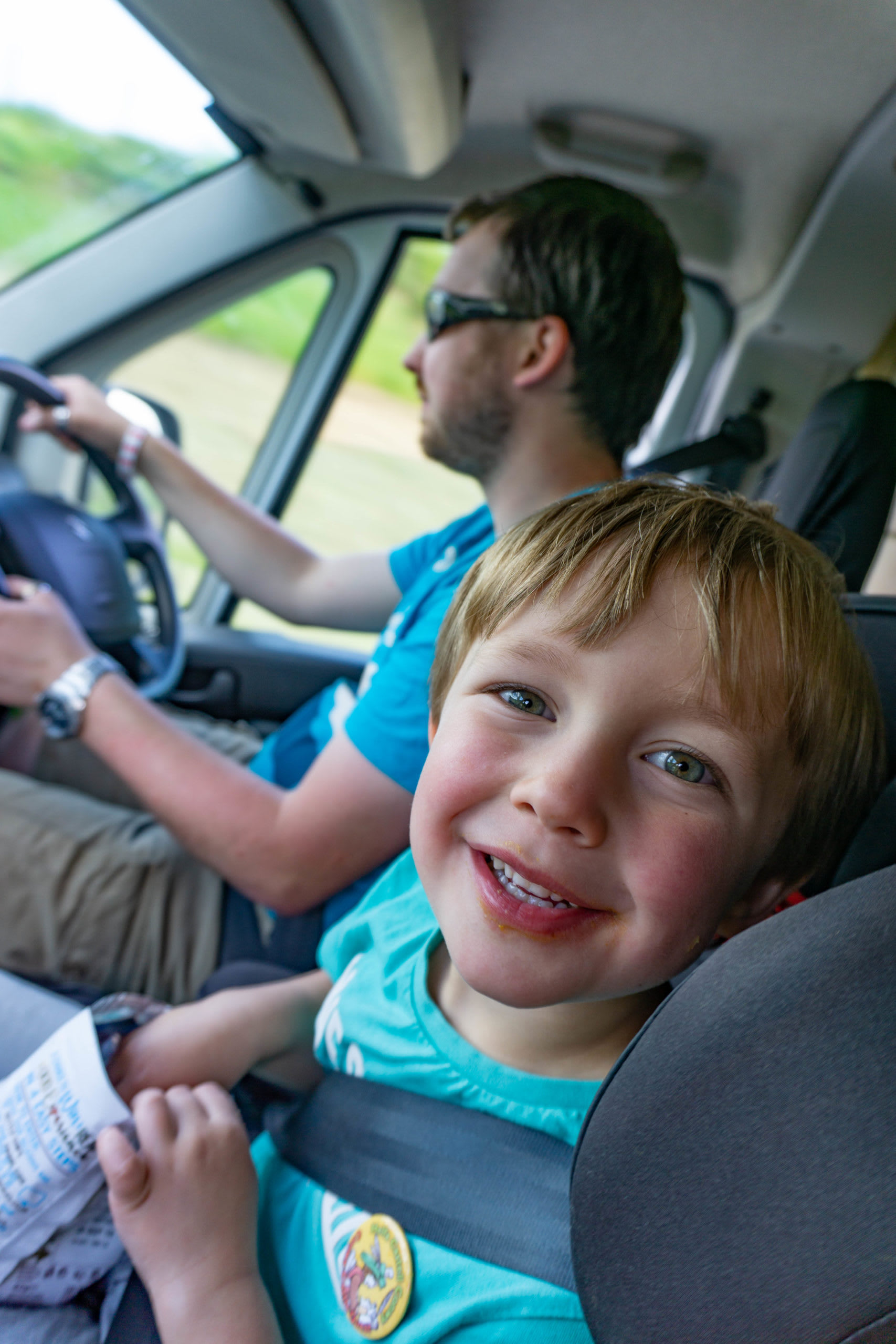 A picture of Jack in a campervan with Ed driving in the background