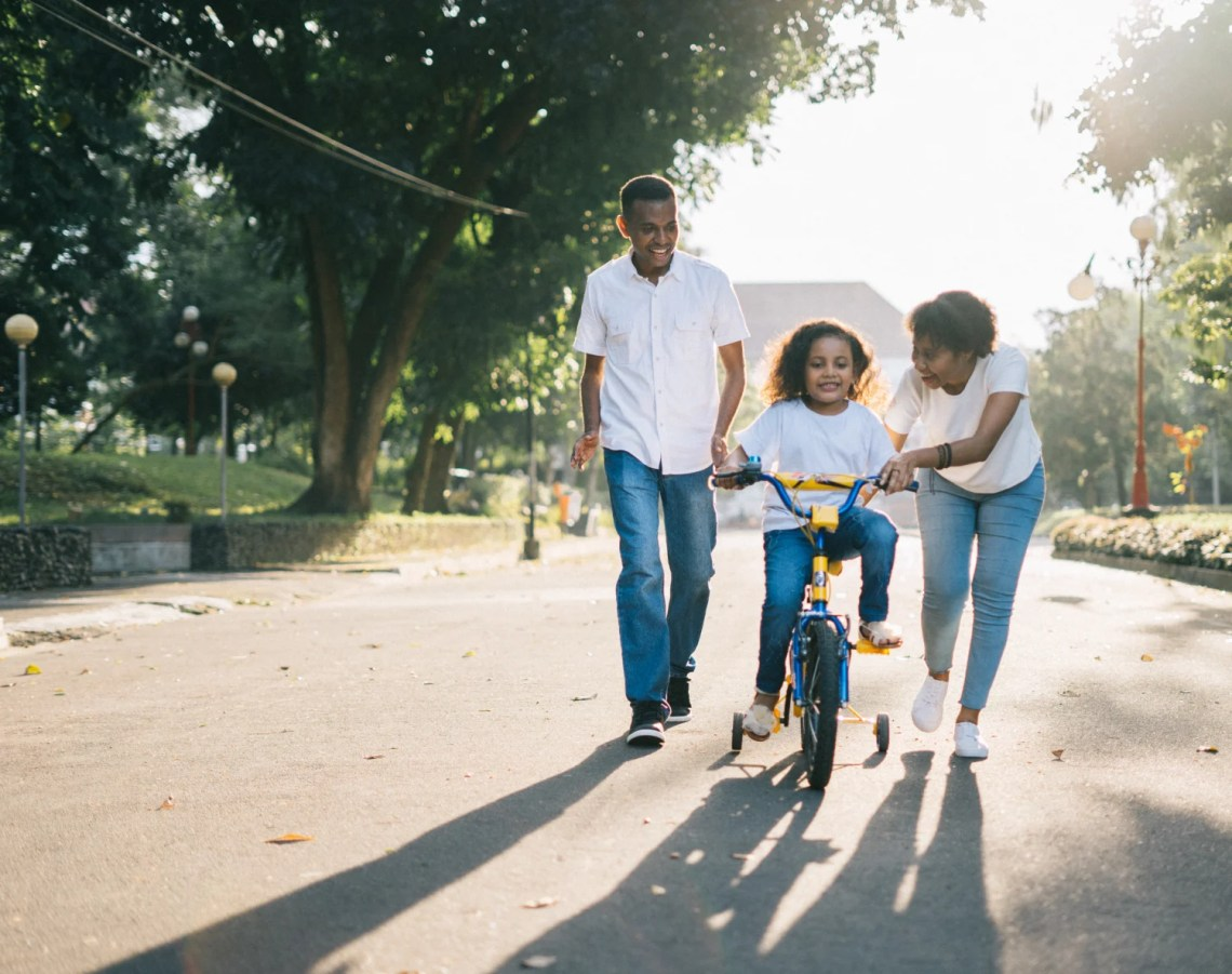 A Family With Child On Bike