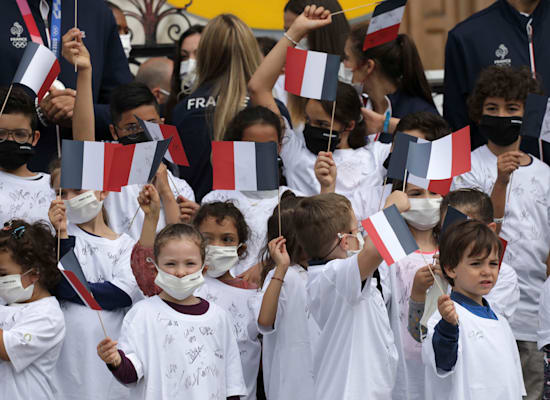 Children waving French flags in Paris, this month / Photo: Associated Press, Adrienne Surprenant