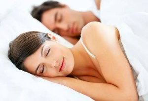 Romantic young couple sleeping in bed