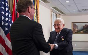 Secretary of Defense Ashton Carter shakes Dr. Henry Kissinger's hand during an award ceremony at the Pentagon on May 9, 2016. (DoD photo by Senior Master Sgt. Adrian Cadiz)
