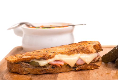 Delicious ham, pork and swiss cheese panini with vegetable soup