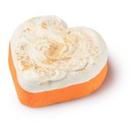 Pain moussant orange et blanc en forme de coeur avec des paillettes or et dorées