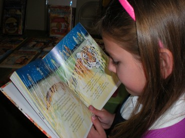 girl reading Renee Meloche Heroes for Young Readers book