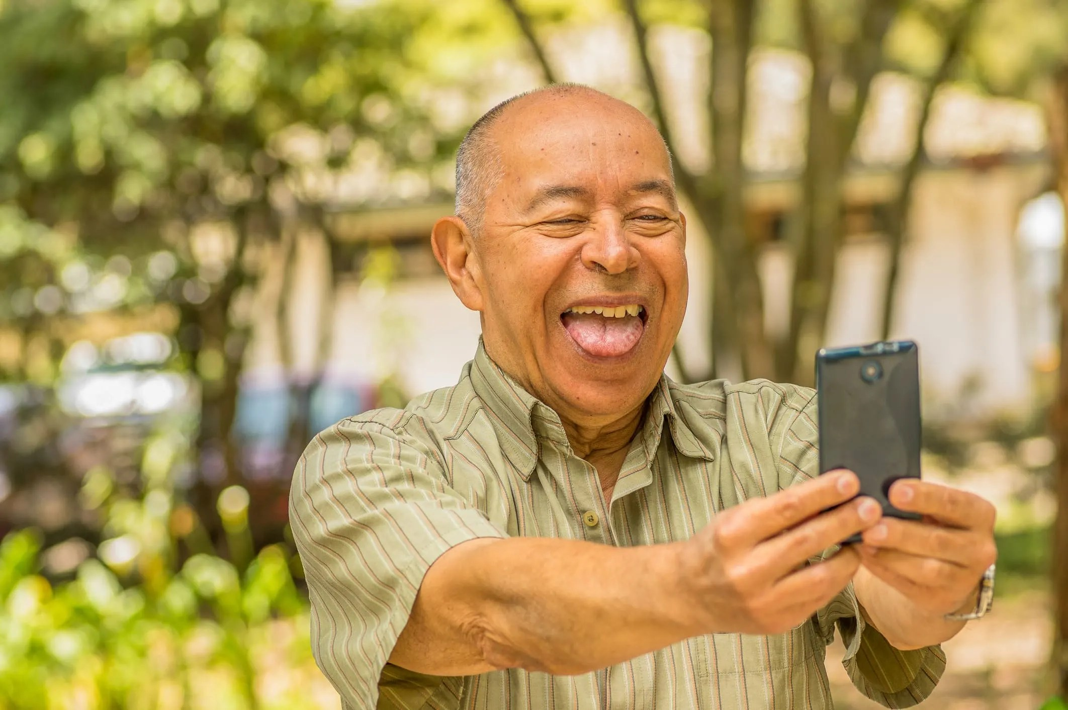Man taking selfie with tongue poking out