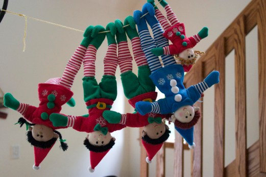 elves hanging by their toes on a string
