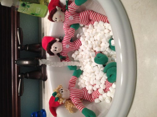elves in a marshmallow hot tub
