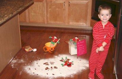 elf making snow angels in flour