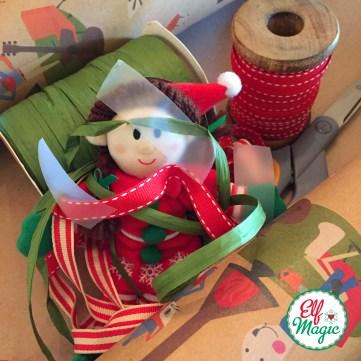 Elf well hidden in the gift wrap