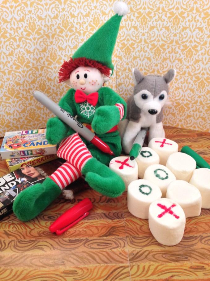 Elf playing marshmallow Tic-Tac-Toe