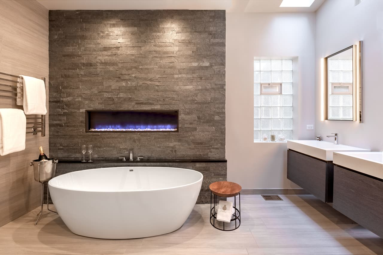stone look tiles and a wall mounted gas