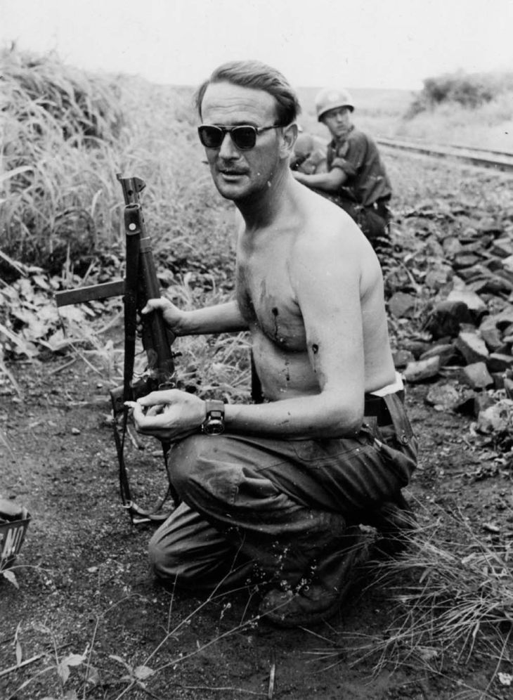 Major Erik Bonde smokes a cigarette
