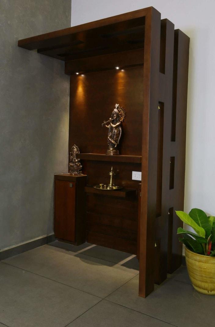 Elegant Prayer Room With Dark Walnut Brown Unit By Madhu