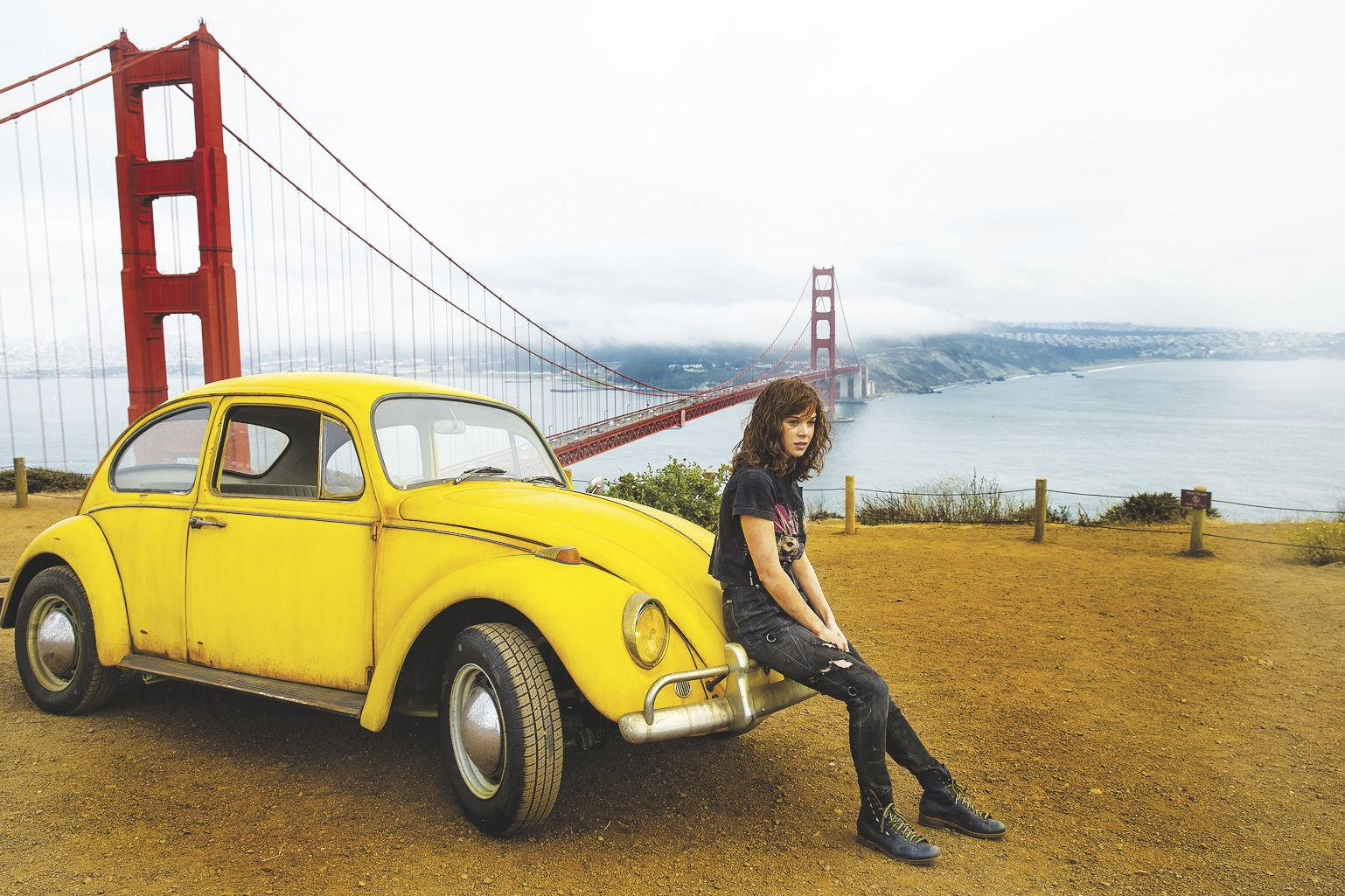 """Bumblebee in his car form and Hailee Steinfeld as Charlie in """"Bumblebee,"""" the sixth film in the live-action """"Transformers"""" franchise. (WILL MCOY/PARAMOUNT PICTURES)"""