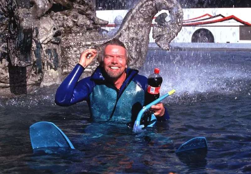 Richard Branson swims in fountain with Virgin Cola bottle