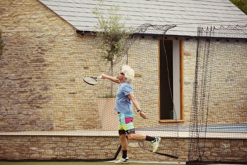 Richard Branson playing tennis in oxford